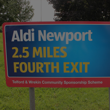 A photograph of a roundabout advertising sign