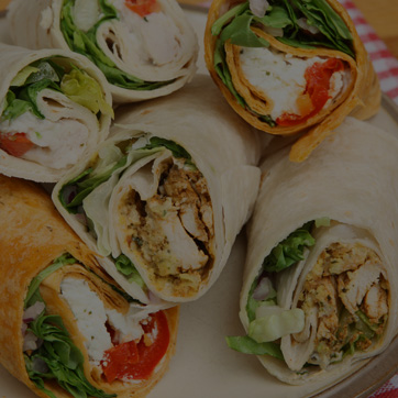 A photograph of wraps with various fillings