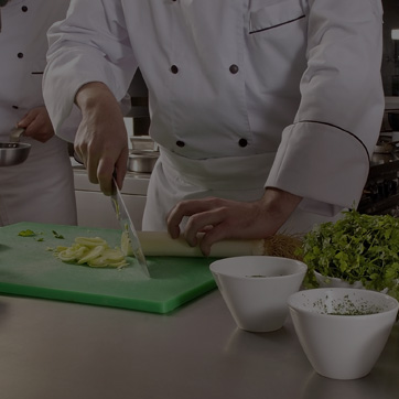 A photograph of a chef preparing food