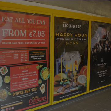 A photograph of advertising posters inside the pedestrian entrance to Southwater Multi-Storey Car Park